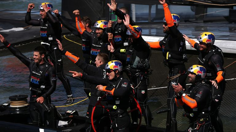 Oracle Team USA skipper Jimmy Spithill leads the celebrates as Team New Zealand beaten in decisive race 19