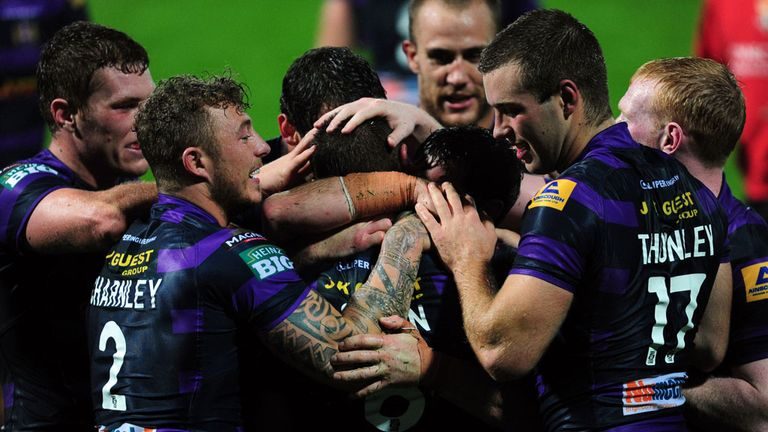 Wigan: Celebrate a Blake Green try during the win over Huddersfield