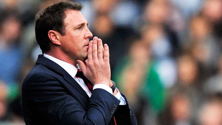 Malky Mackay: Has the backing of the dressing room and will not be leaving Cardiff