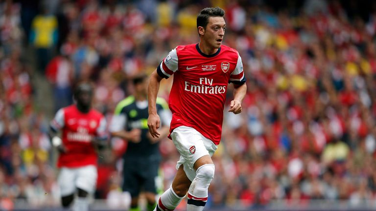 Mesut Ozil: Had a hand in all three of Arsenal's goals on his home debut