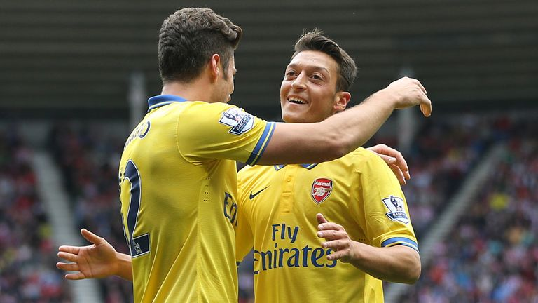 Ozil and Giroud celebrate the opener