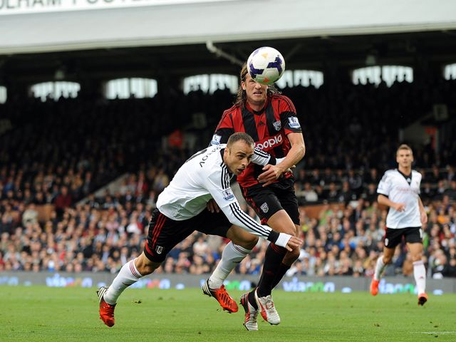 Dimitar Berbatov and Jonas Olsson battle for possession