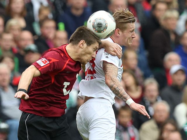 Sebastien Pocognoli and Andre Hahn battle for the ball