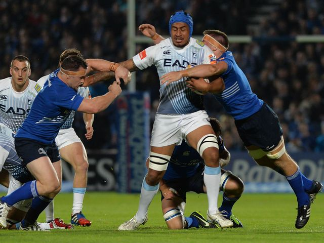 Filo Paulo is tackled by Cian Healy left and Dominic Ryan