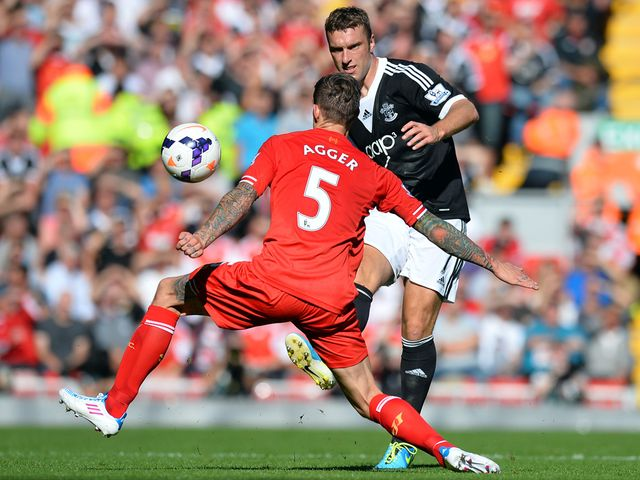 Rickie Lambert knocks the ball away from Daniel Agger.