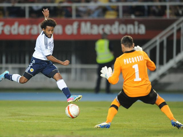 Ikechi Anya scores the opening goal for Scotland