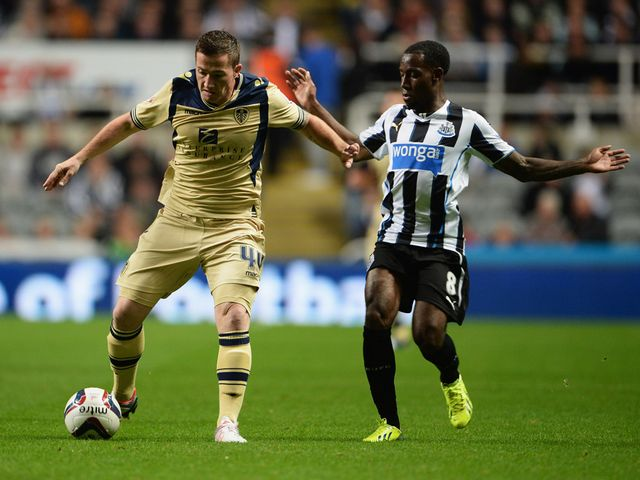 Ross McCormack keeps the ball away from Vurnon Anita