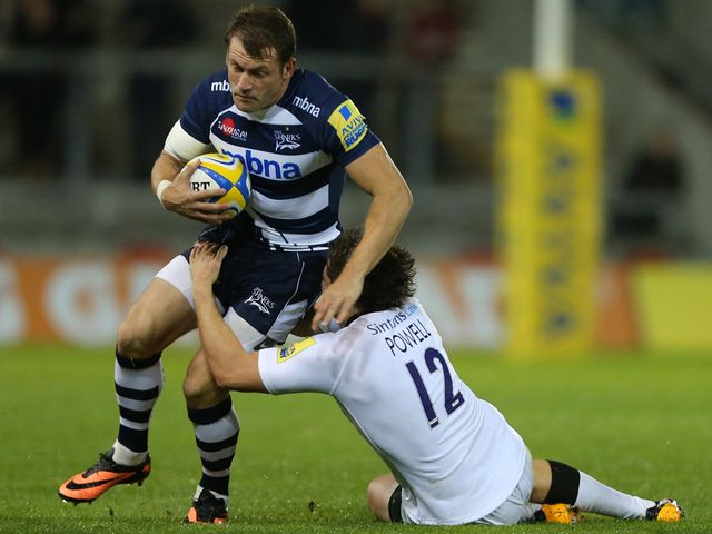 Mark Cueto is tackled by Adam Powell
