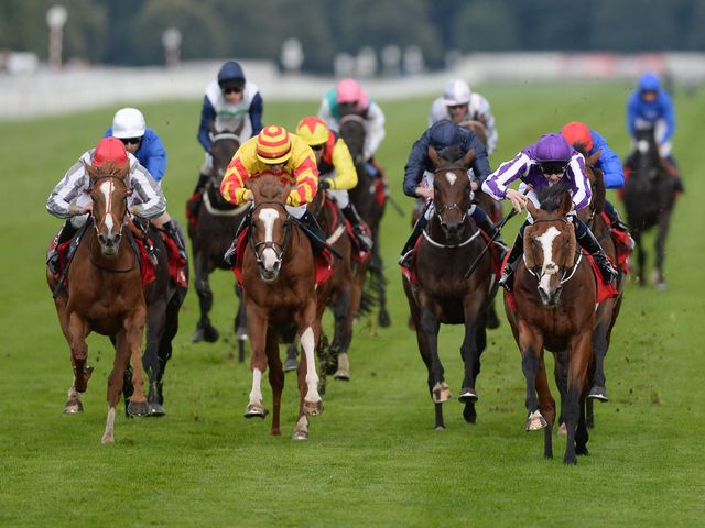 Leading Light (right) denies Talent (red cap) to land the Leger