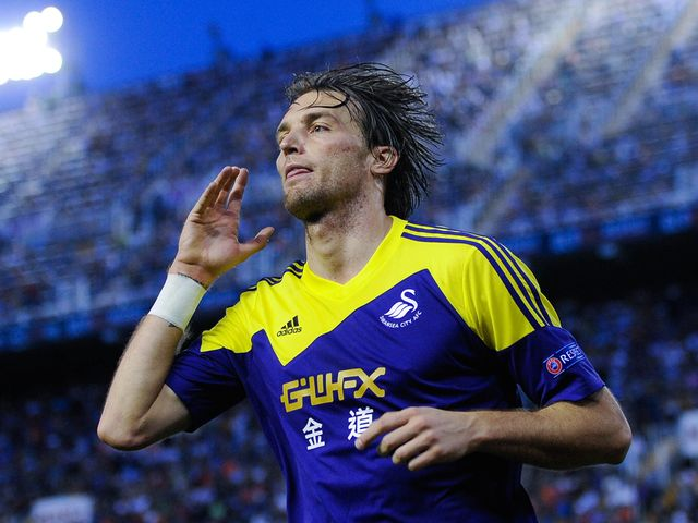 Michu celebrates scoring Swansea's second goal