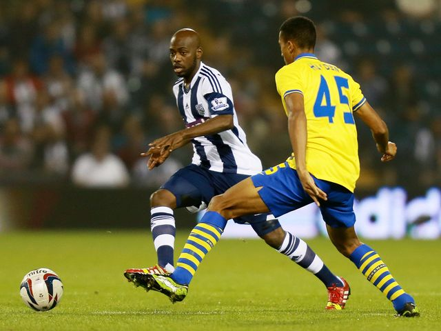 Youssouf Mulumbu plays the ball away from Isaac Hayden