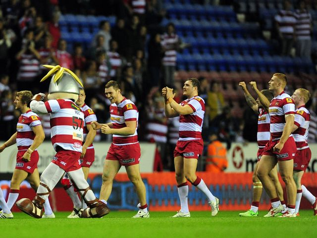 Wigan players celebrate victory over Leeds