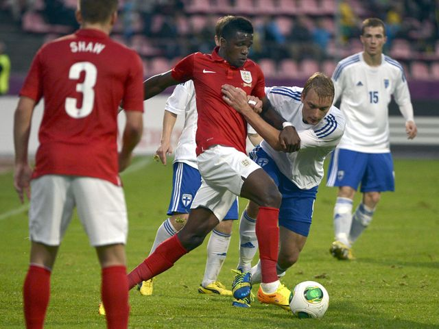 Wilfried Zaha tries to get England going forward against the Finns