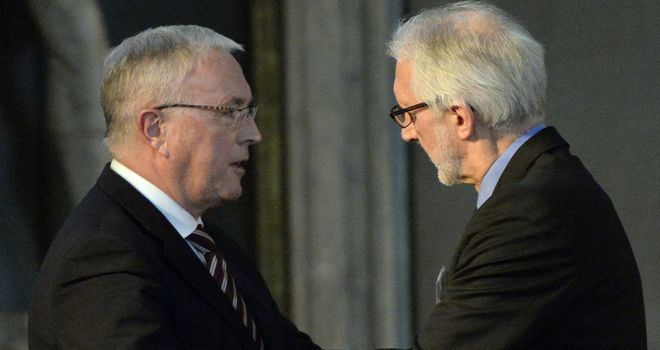 Brian Cookson, right, replaced Pat McQuaid, left, as UCI president last month