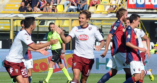 Alessio Cerci celebrates after netting from the spot for Torino