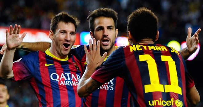 Lionel Messi celebrates after scoring Barca's second