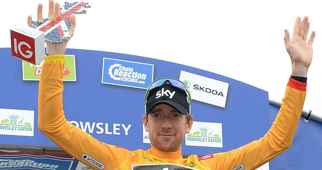 Bradley Wiggins is wearing the leader's gold jersey