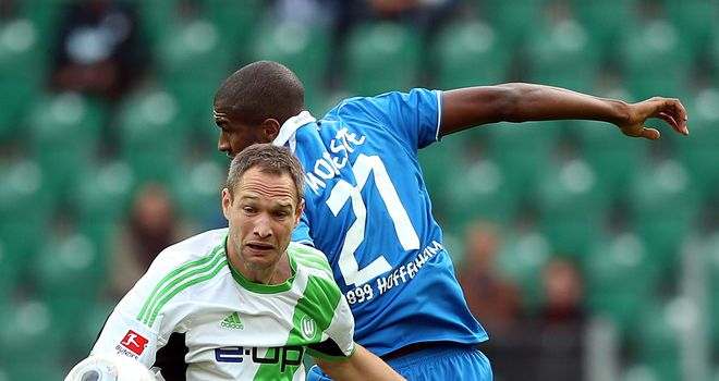 Jan Polak of Wolfsburg challenges Anthony Modeste of Hoffenheim