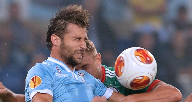 Lazio defender Lorik Cana fights for the ball