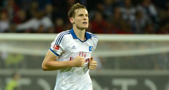 Marcell Jansen of Hamburg celebrates after scoring late on