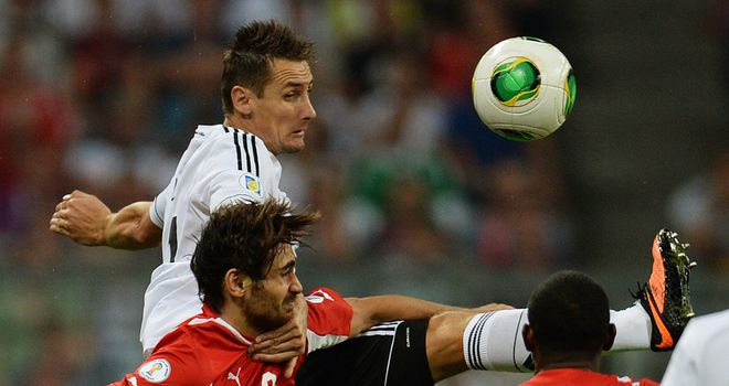 Miroslav Klose wins an aerial battle