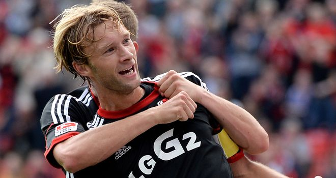 Simon Rolfes: Celebrates after scoring for Leverkusen
