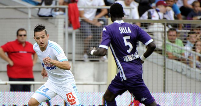 Florian Thauvin tries to get past Issiaga Sylla