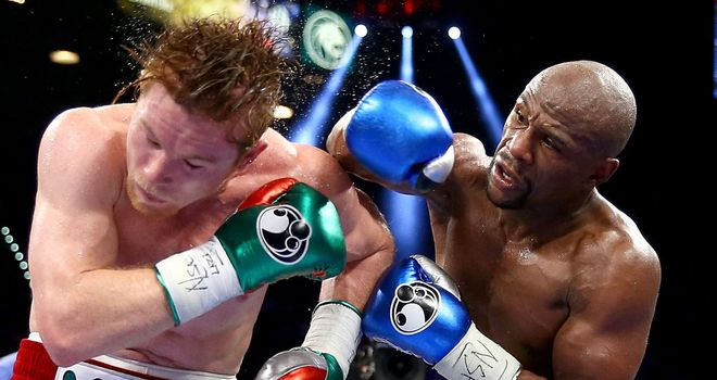 Floyd Mayweather lands a right hand on the way to a majority decision