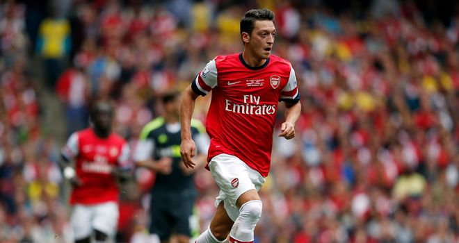Mesut Ozil: Involved in all three of Arsenal's goals against Stoke on Sunday