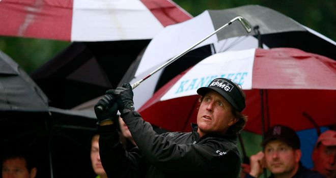 Phil Mickelson hits off the second tee on a soggy Sunday in Illinois