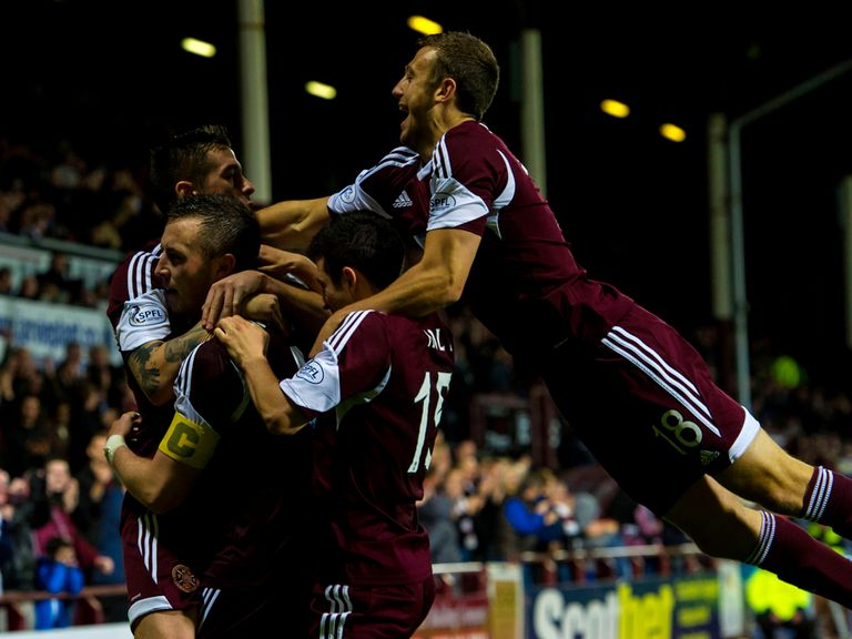 Hearts knocked out Queen of the South on penalties.