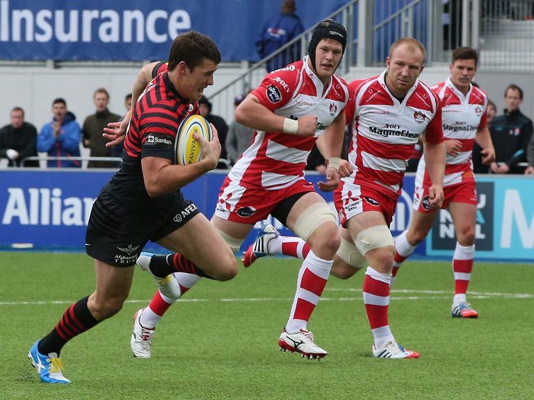 Joel Tomkins sprints clear to score the opening try for Saracens