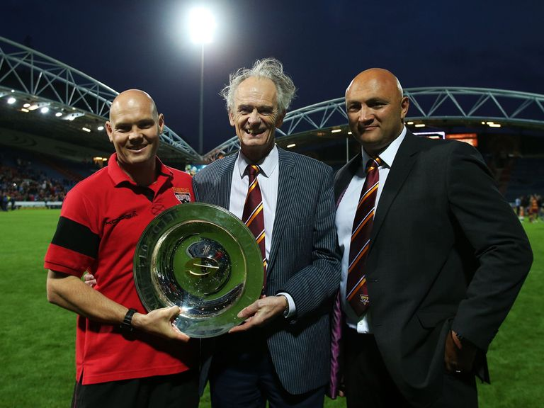 Giants chairman Ken Davy with the league leaders shield