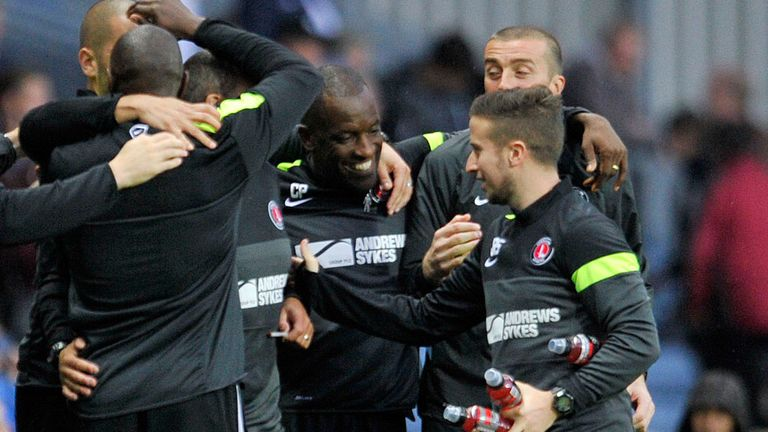Chris Powell celebrates with his backroom staff