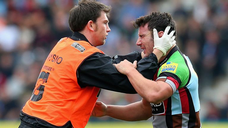 George Lowes receives treatment for the injury that ended his season with Harlequins