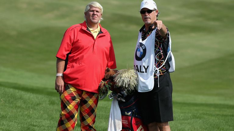 Colourful John Daly speaks to his caddie during Thursday's opening round in Shanghai