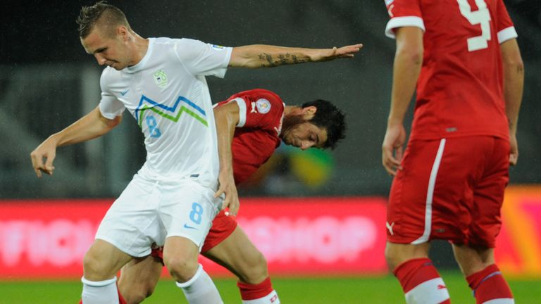 Jasmin Kurtic and Blerim Dzemaili tussle for the ball