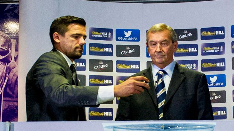 Former Rangers player Nacho Novo and SFA president Campbell Ogilvie carry out draw at Hampden