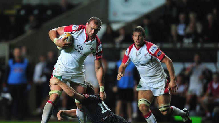 Ulster's Dan Tuohy runs through the attempted tackle of Dan Biggar