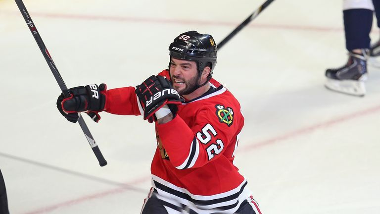 Brandon Bollig celebrates his first period goal for the Chicago Blackhawks