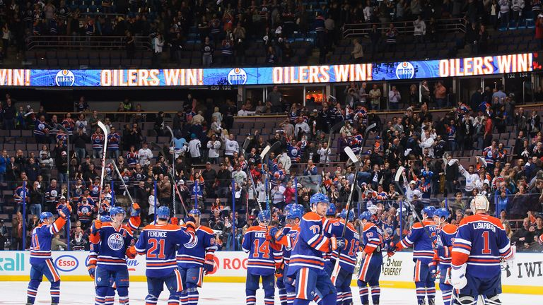 The Edmonton Oilers celebrate their shootout victory over the New Jersey Devils
