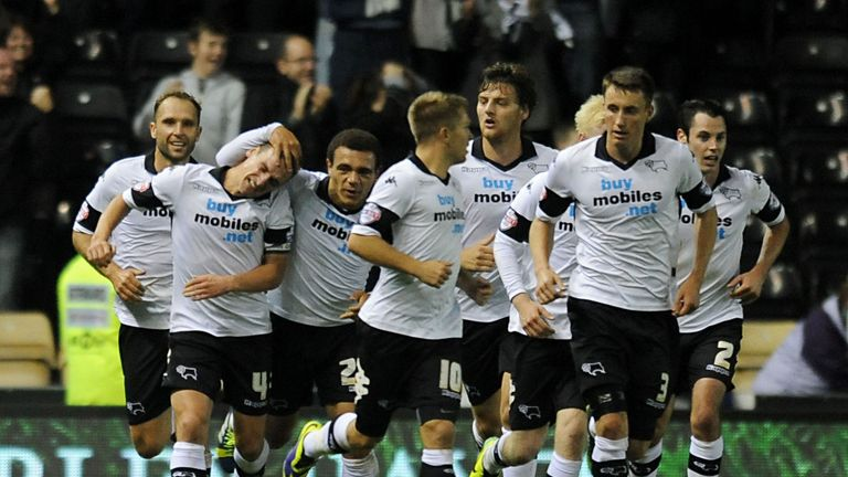 Craig Bryson (second from left): Celebrates late equaliser