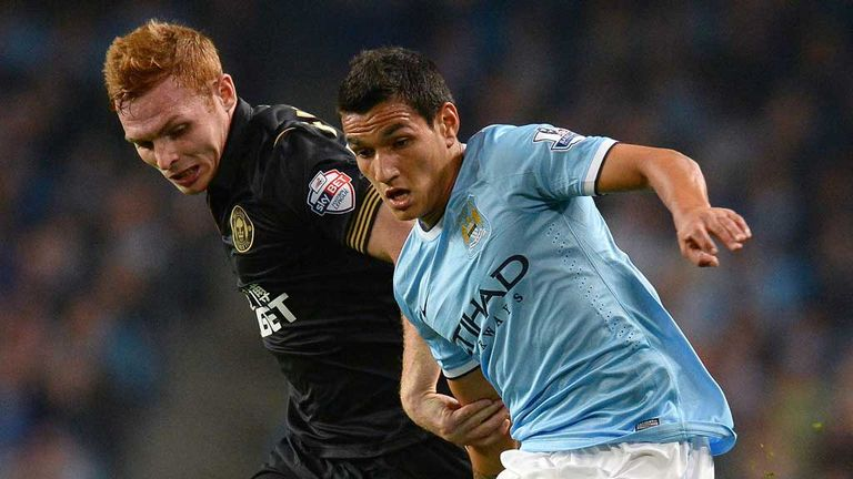 Fraser Fyvie in action for Wigan against Manchester City