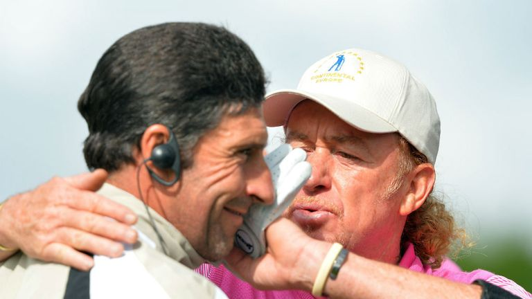 Miguel Angel Jimenez celebrates his foursomes victory with European captain Jose Maria Olazabal