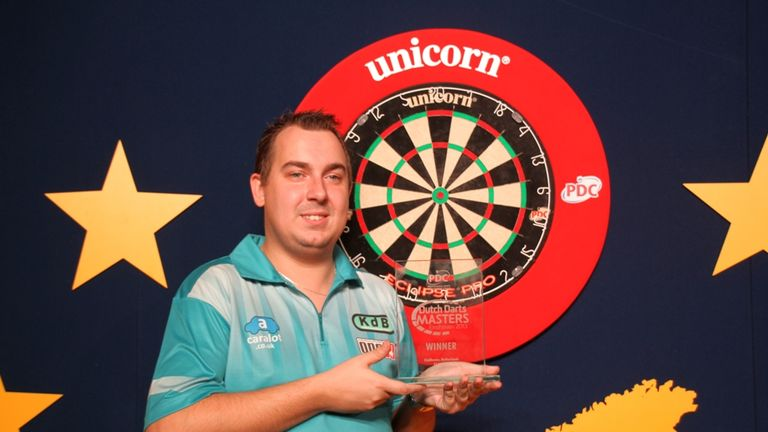 Kim Huybrechts celebrates his Dutch Darts Masters title (Picture by Carsten Arlt, PDC Europe)