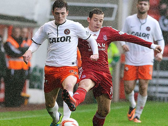 Andrew Robertson takes on Peter Pawlett