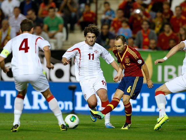 Andres Iniesta finds himself surrounded