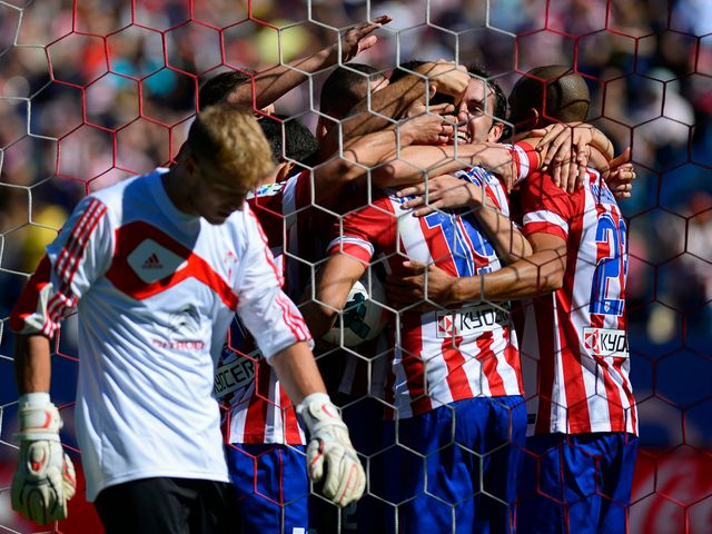 Atletico Madrid celebrate their opening goal