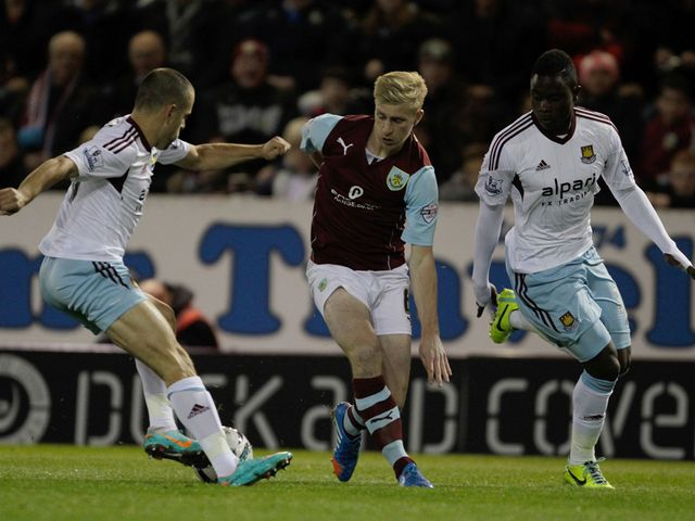 Joe Cole wins the ball from Ben Mee