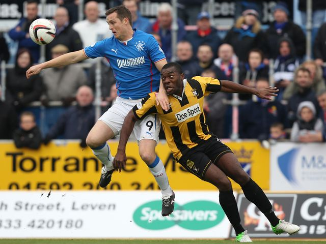 Jon Daly holds off Joe Mbu.